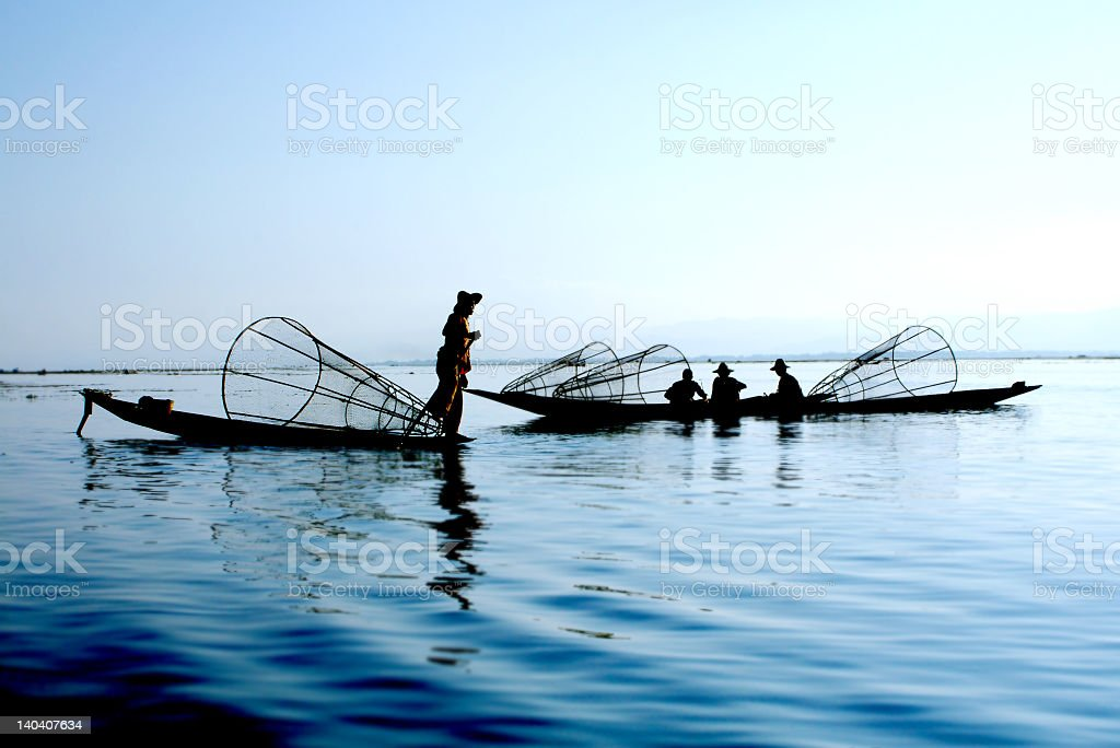 A fisherman with nets on the water royalty-free stock photo
