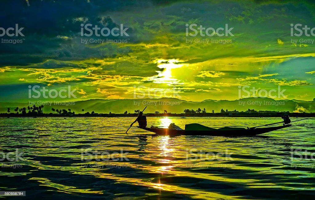 Fisherman with the Sunset stock photo