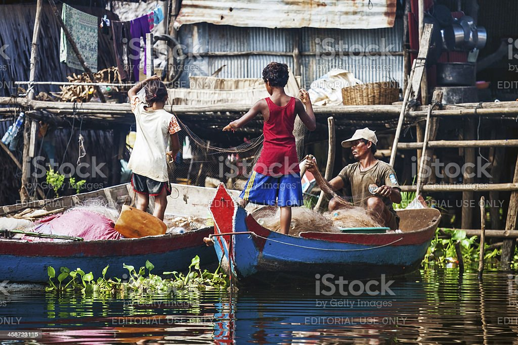 Fisherman with their children prepare tackle royalty-free stock photo