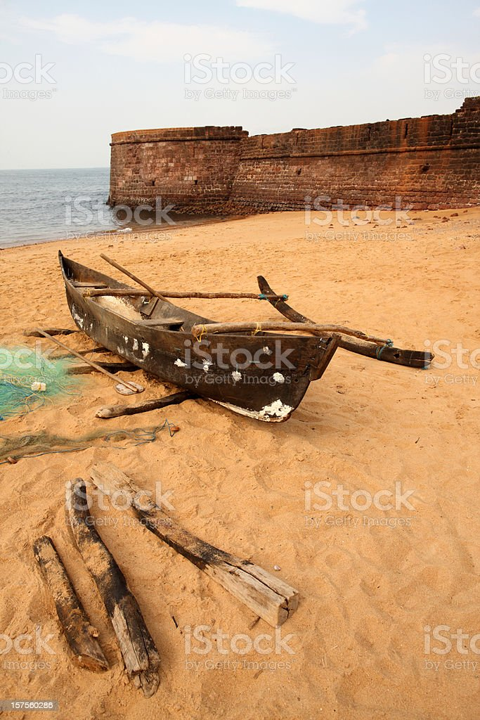 Fisherman's boat at Aguada Fort stock photo