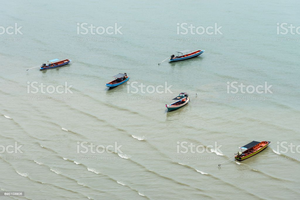 Fisherman's boat near beach with small wave in Thailand. stock photo