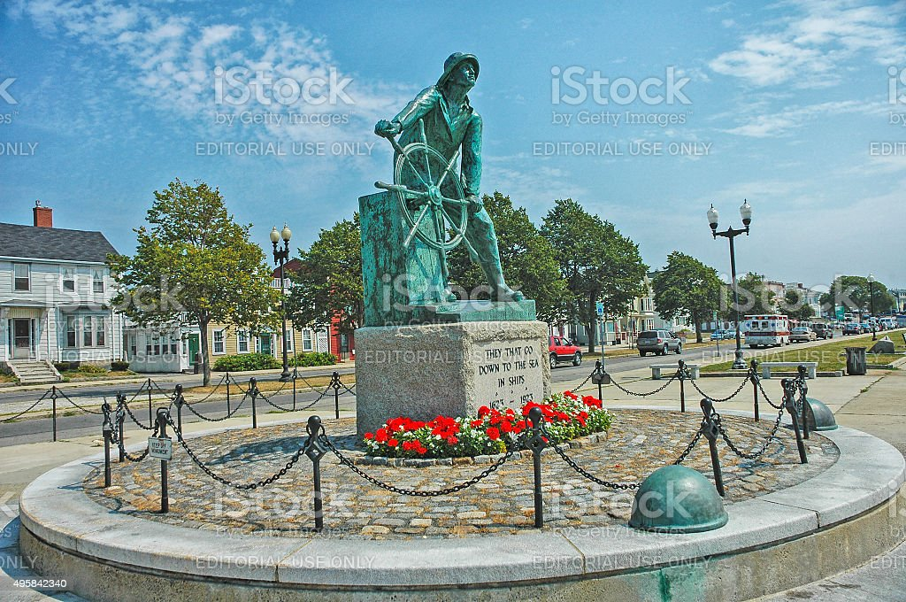 Fishermans Memorial Man at the Wheel Gloucester Massachusetts with Flowers stock photo
