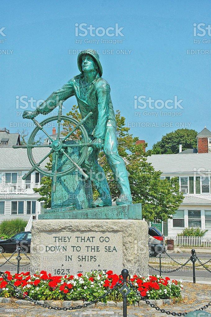 Fishermans Memorial with flowers in Gloucester Massachusetts stock photo