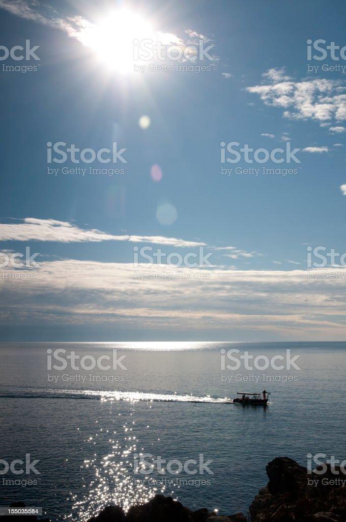 Fishermans returning home stock photo