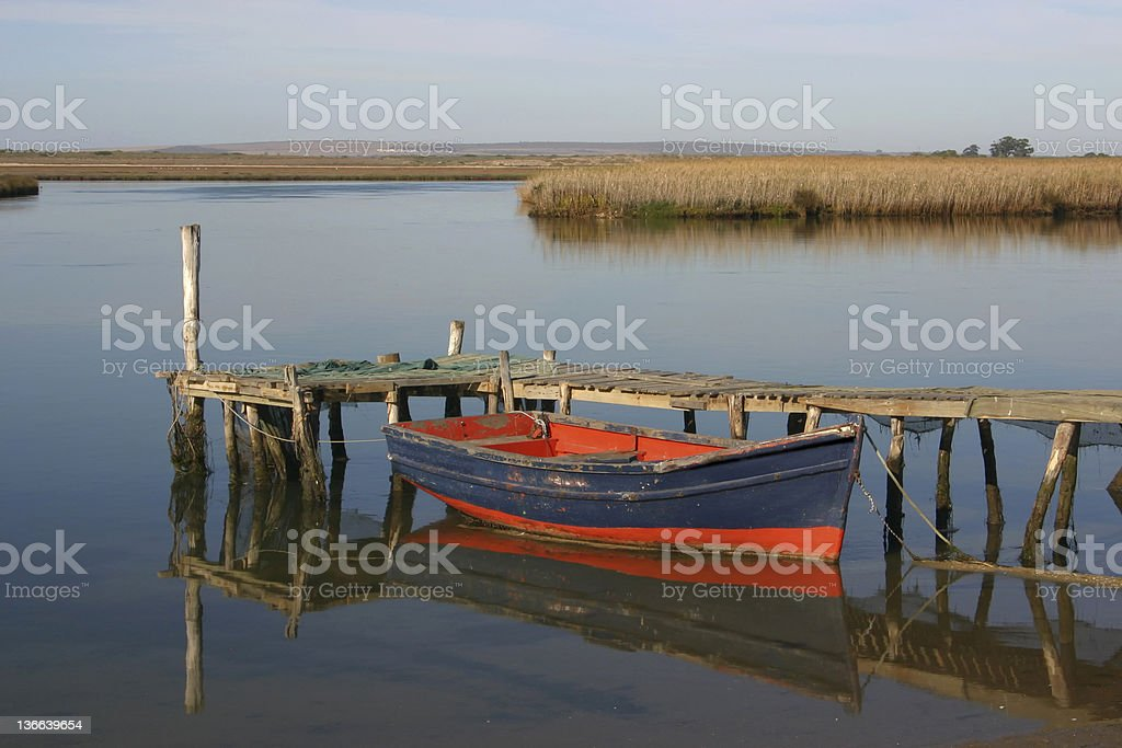 Fisherman's rowboat on lagoon at Velddrif in South Africa royalty-free stock photo