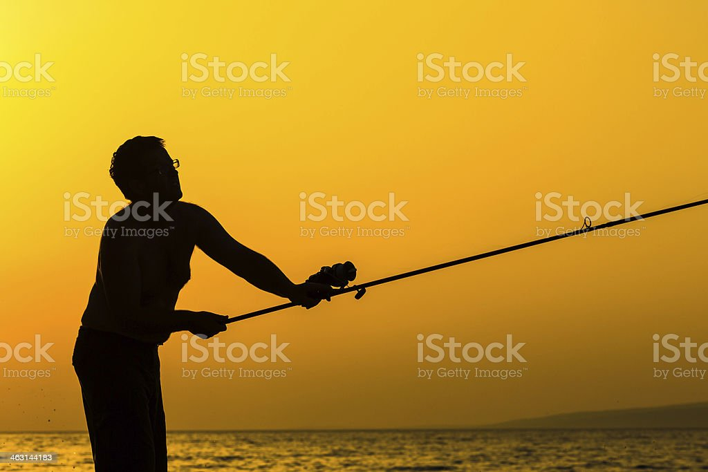 Fisherman's silhouette on the beach royalty-free stock photo