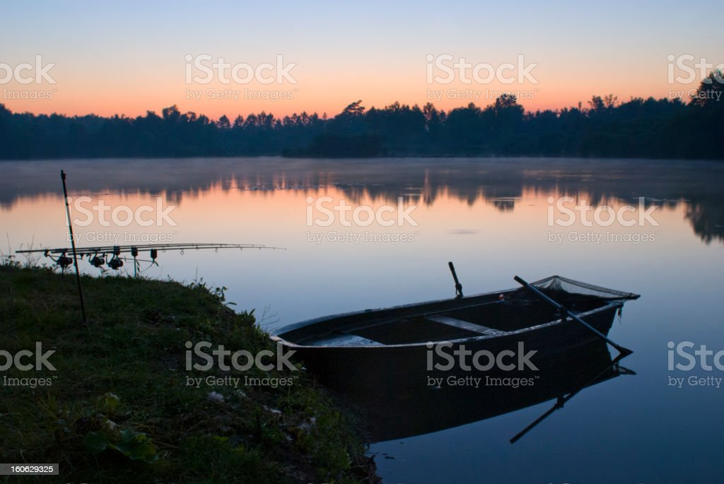Fisherman's twighlight at a calm lake stock photo