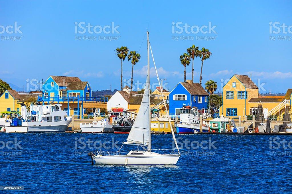 Fishermans Village at Marina Del Rey harbor with sailboat,CA stock photo