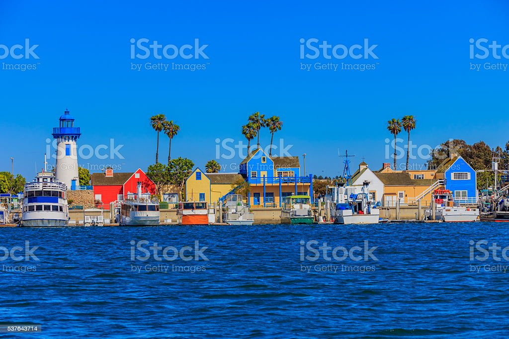 Fishermans Village at Marina Del Rey with waterfront lighthouse, CA stock photo