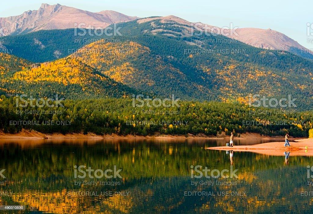 Fishermen and Autumn Aspen at Crystal Creek Reservoir stock photo