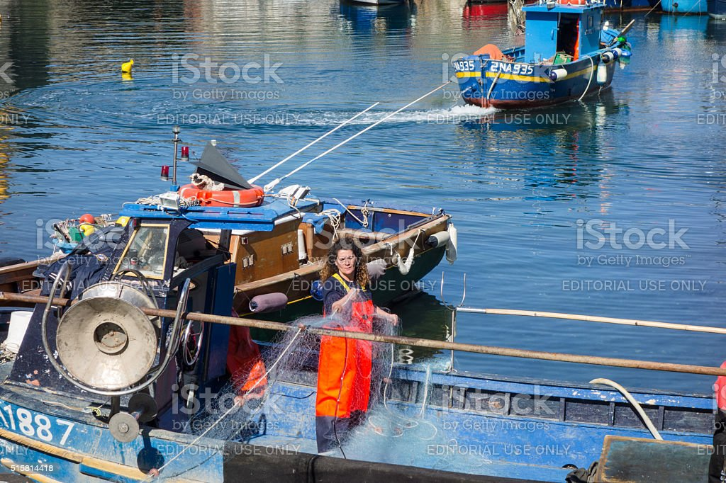 Fishermen and Fisherwoman at work stock photo