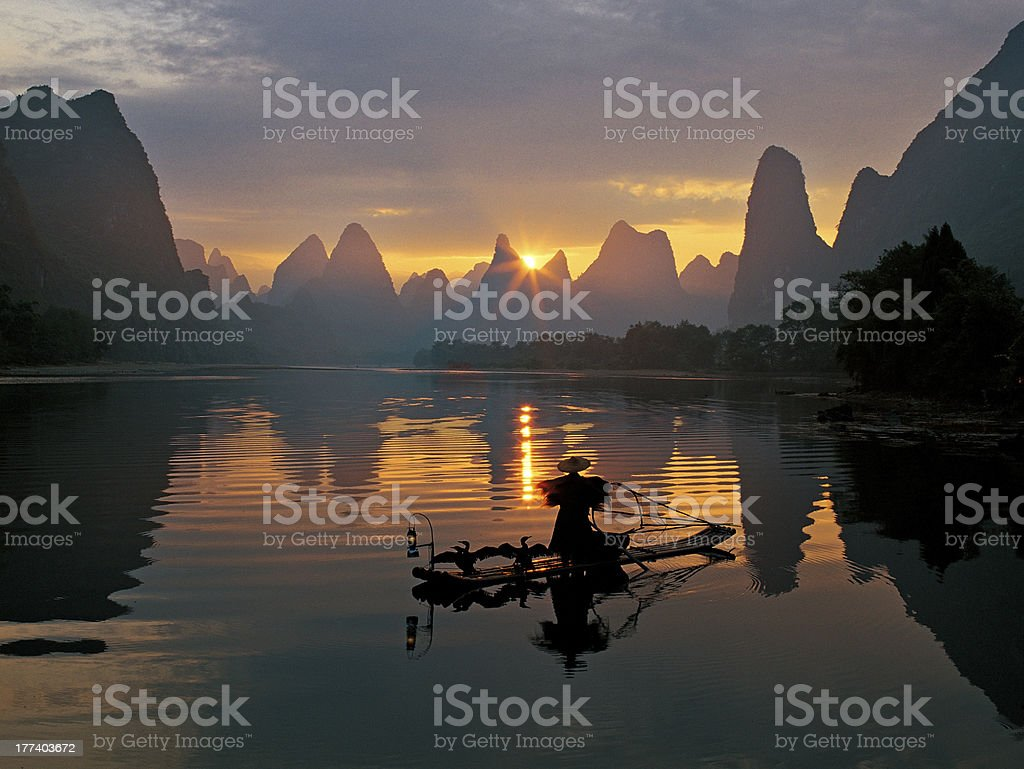 Fishermen and osprey in Li River royalty-free stock photo
