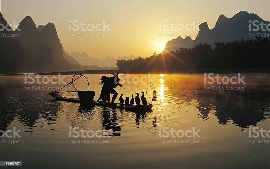 Fishermen and osprey stock photo