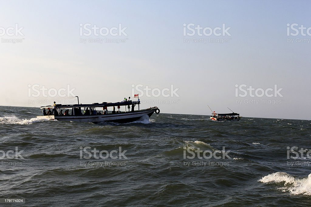 Fishermen and waves royalty-free stock photo
