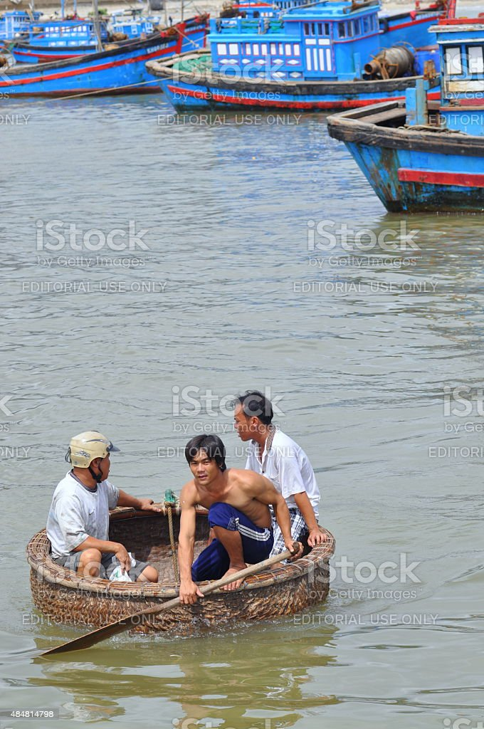 Fishermen are swimming from their vessels to the seaport stock photo