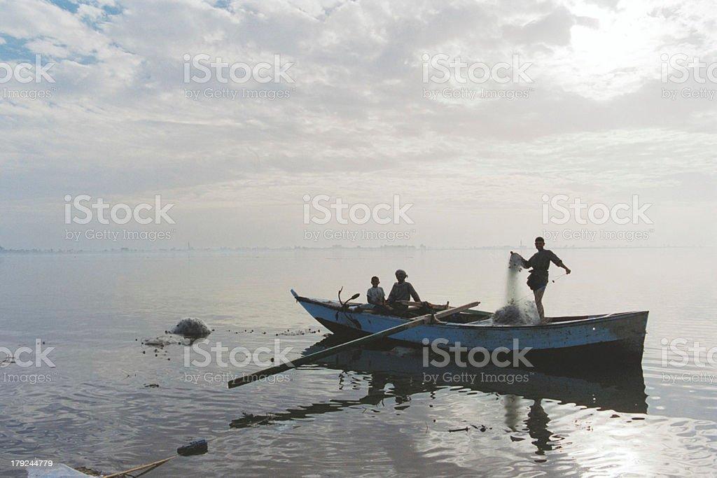 Fishermen at Sunset royalty-free stock photo