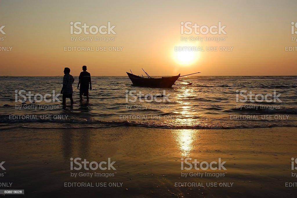 Fishermen at Sunset stock photo