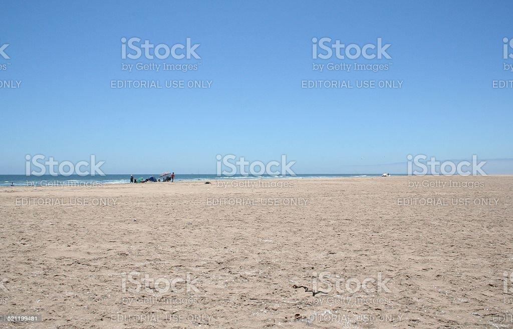 Fishermen at the Beach of Walvis Bay, Swakopmund, Namibia, Africa stock photo