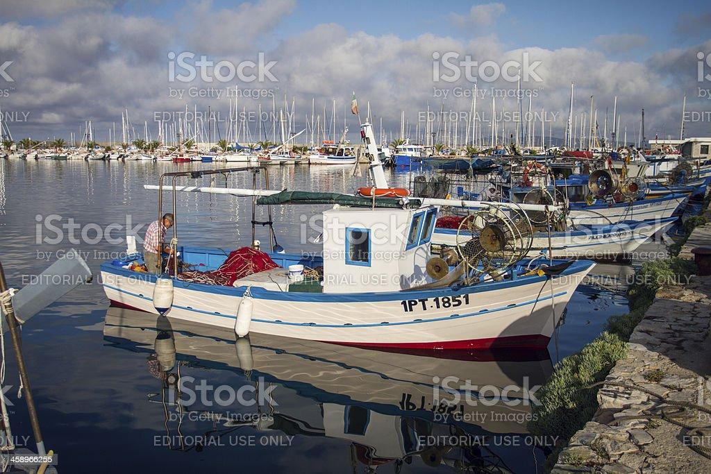 Fishermen at work, by the Harbor of Alghero, Sardinia, Italy stock photo