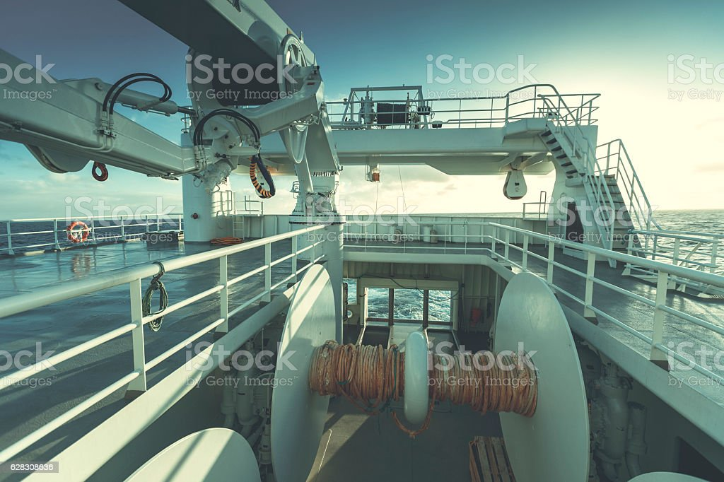 Fishermen at work: from the trawler with sailing stock photo