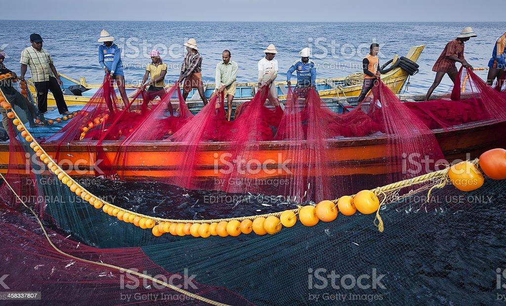 Fishermen at work, Kannur, Kerala, India. royalty-free stock photo