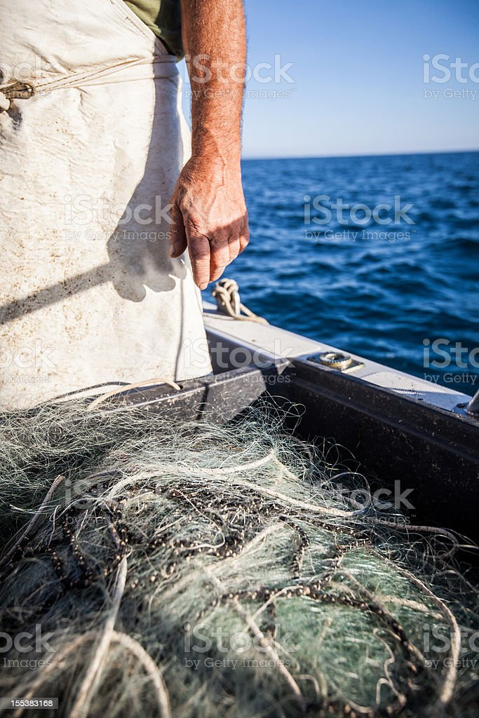 Fishermen at work, on a trawler with nets royalty-free stock photo