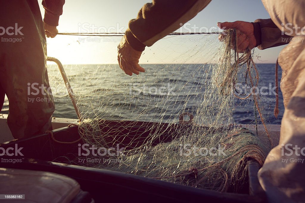 Fishermen at work, pulling the nets stock photo