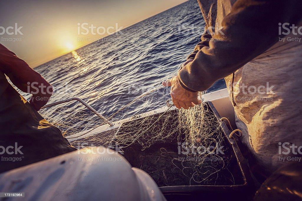 Fishermen at work, pulling the nets stock photo