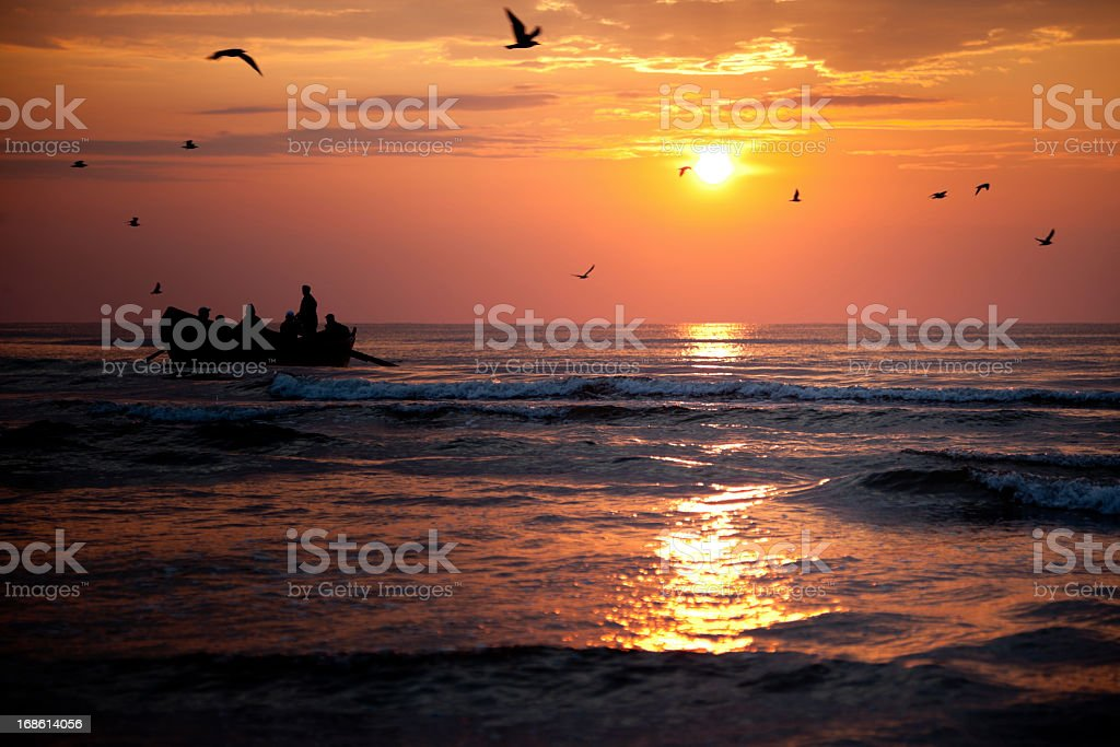 Fishermen Boat And Sunrise On Sea royalty-free stock photo