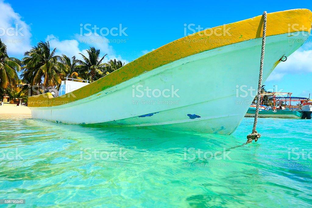 Fishermen boat, Cancun palm beach - caribbean tropical paradise stock photo