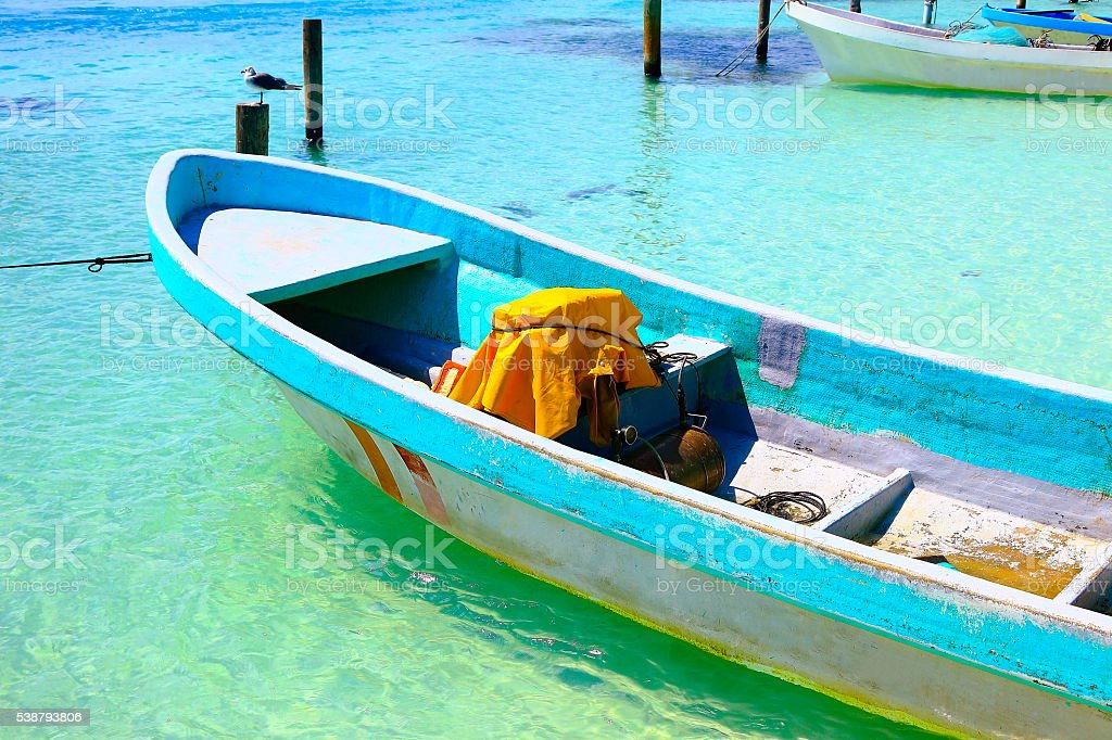 Fishermen boat, pier, dove sea bird - caribbean tropical paradise stock photo