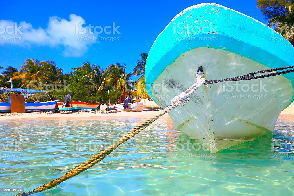 Fishermen boats, Cancun palm beach - caribbean tropical paradise stock photo