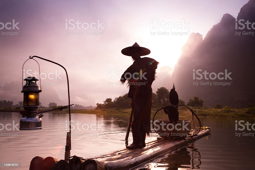 Fishermen  fashing on Li River stock photo