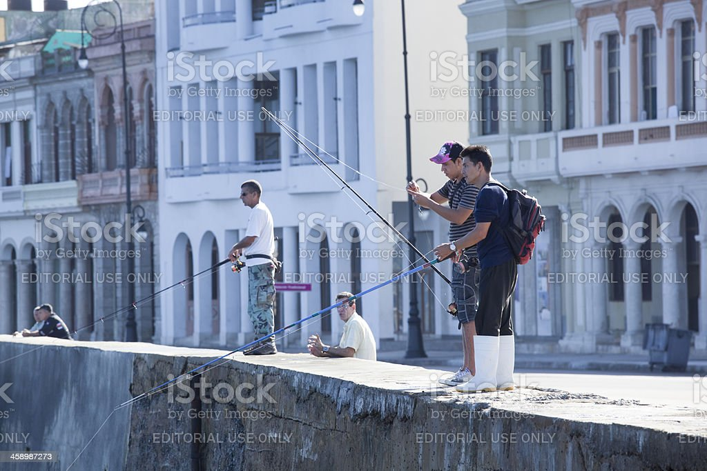 Fishermen Fishing Along the Sea Wall Malecón in Havana Cuba royalty-free stock photo