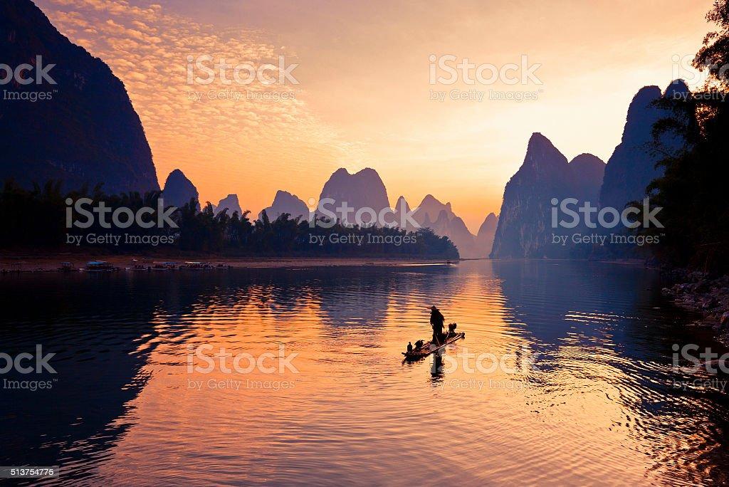 Fishermen fishing in Li River stock photo