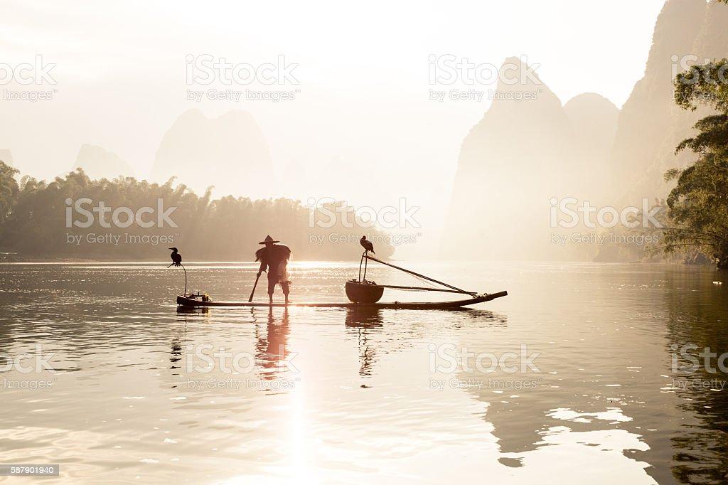 Fishermen fishing on Li River stock photo
