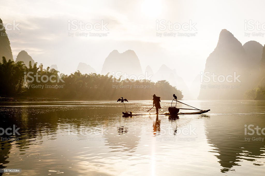 Fishermen fishing on Li River stock photo