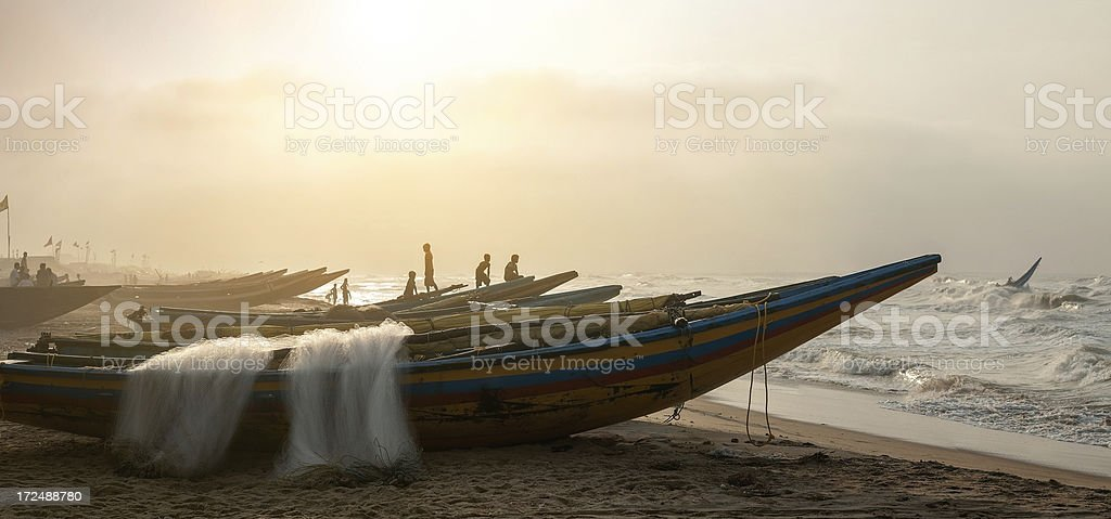 Fishermen going out to the sea. stock photo