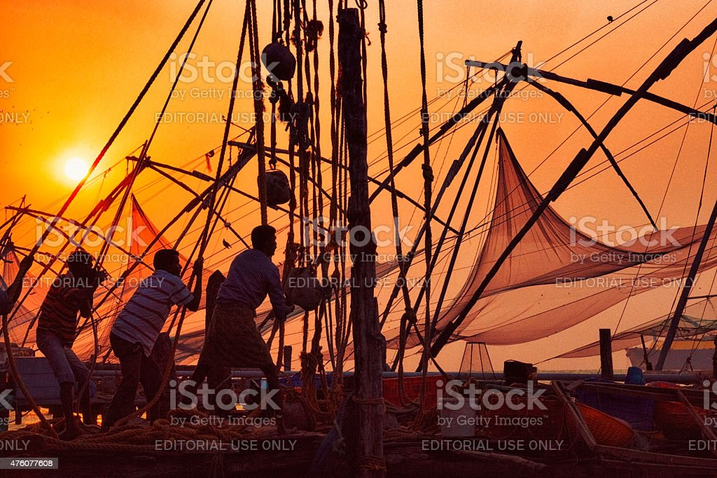 Fishermen hauling net in Kochi, India stock photo