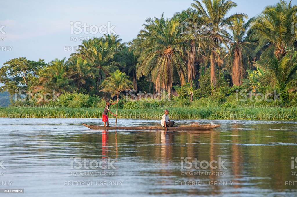 Fishermen in a pirogue on Congo River stock photo