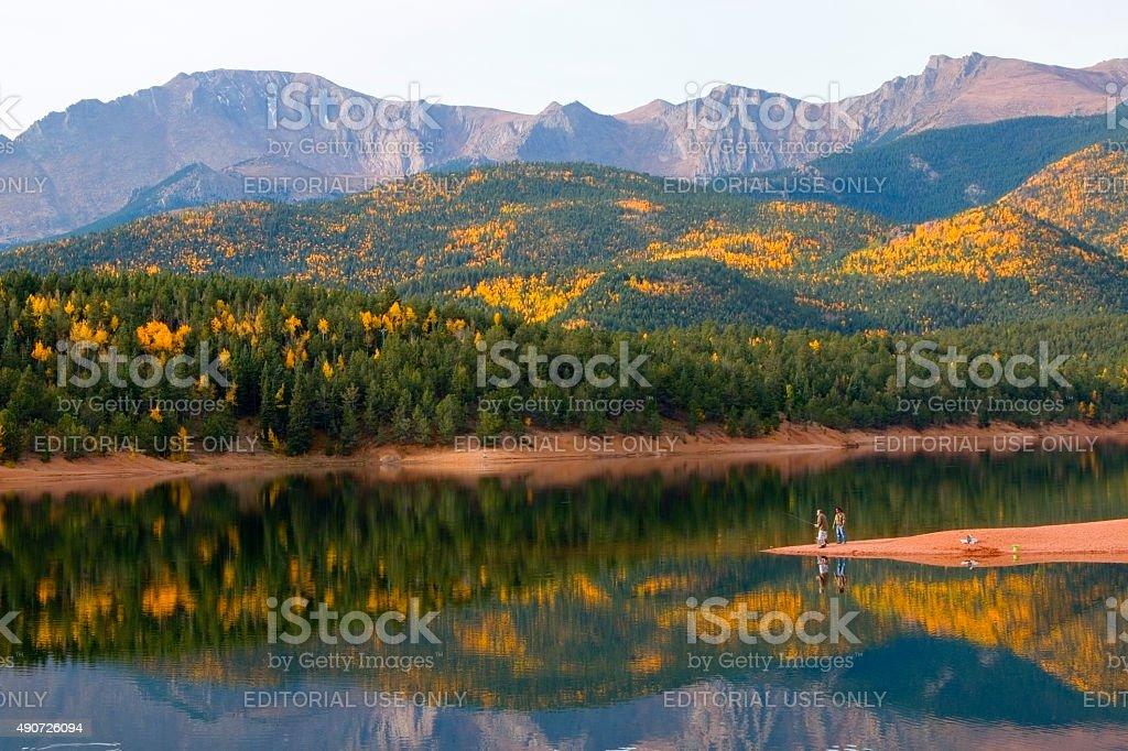 Fishermen in Autumn Aspen at Crystal Creek Reservoir stock photo