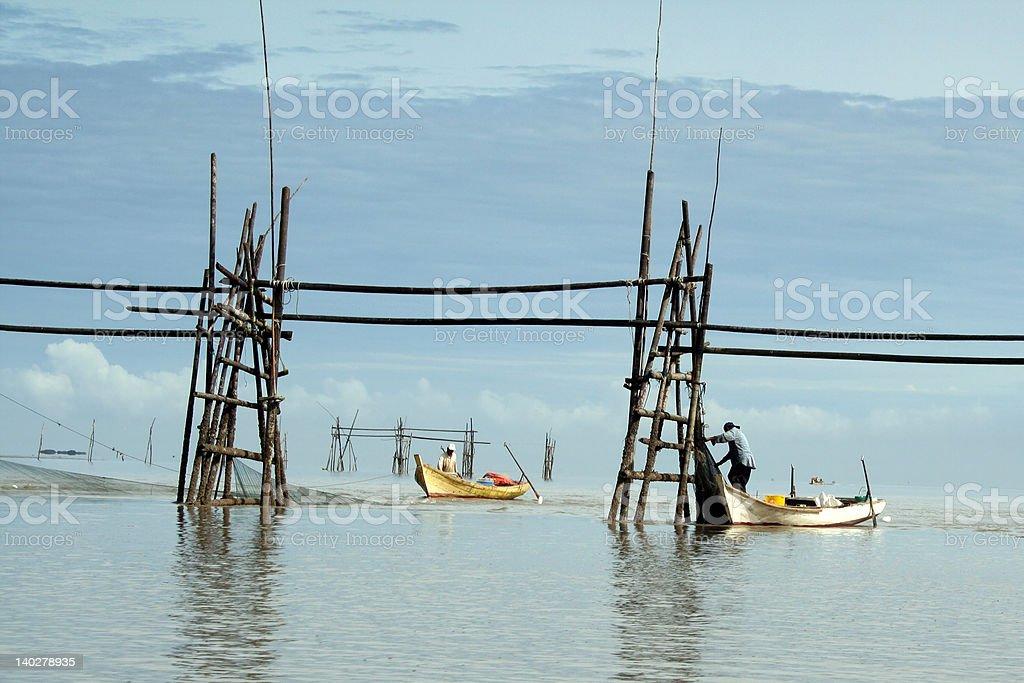 Fishermen in Bako stock photo