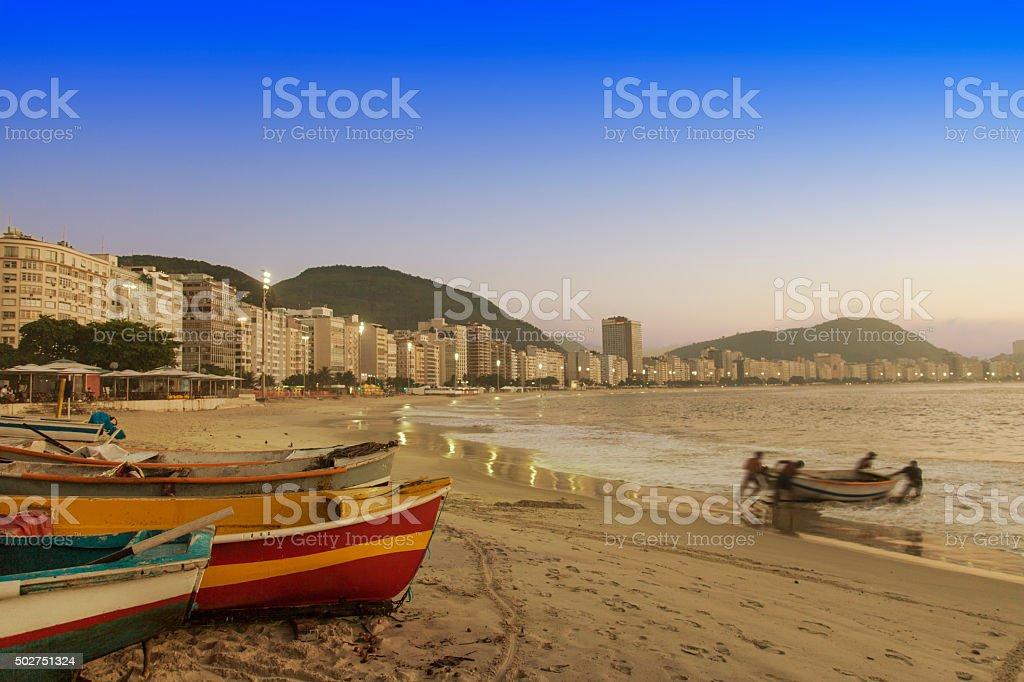 Fishermen in Copacabana Beach sunrise stock photo
