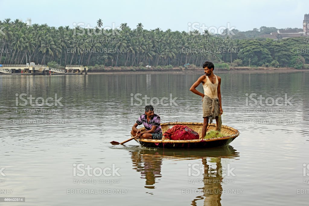 Fishermen in Coracle Boat Harvest Fish stock photo
