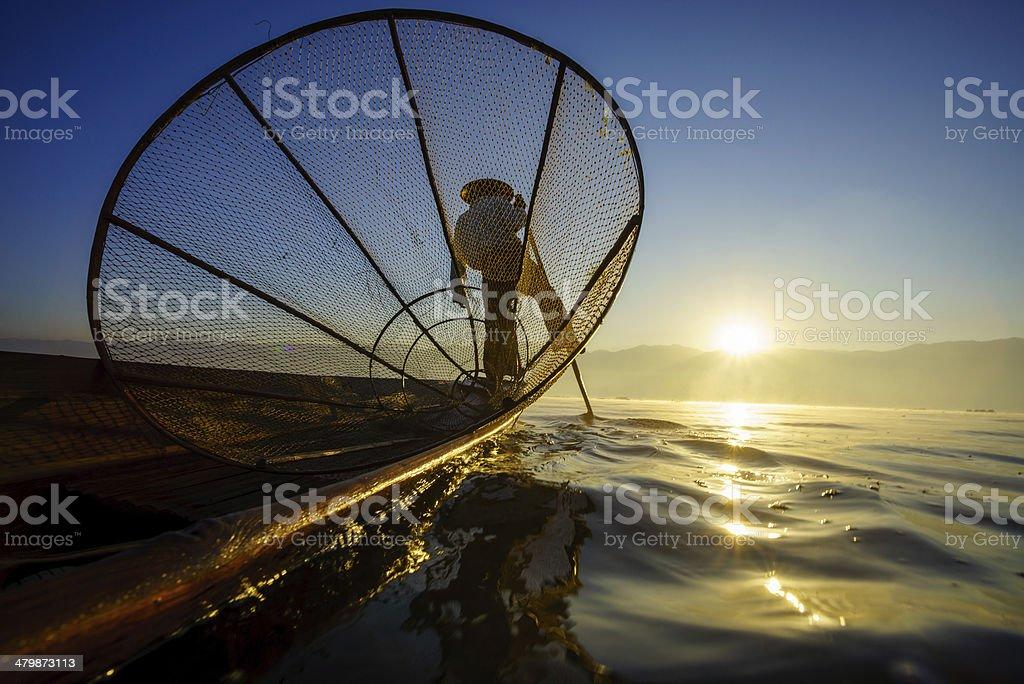 Fishermen in Inle Lake at sunrise, Shan State, Myanmar stock photo