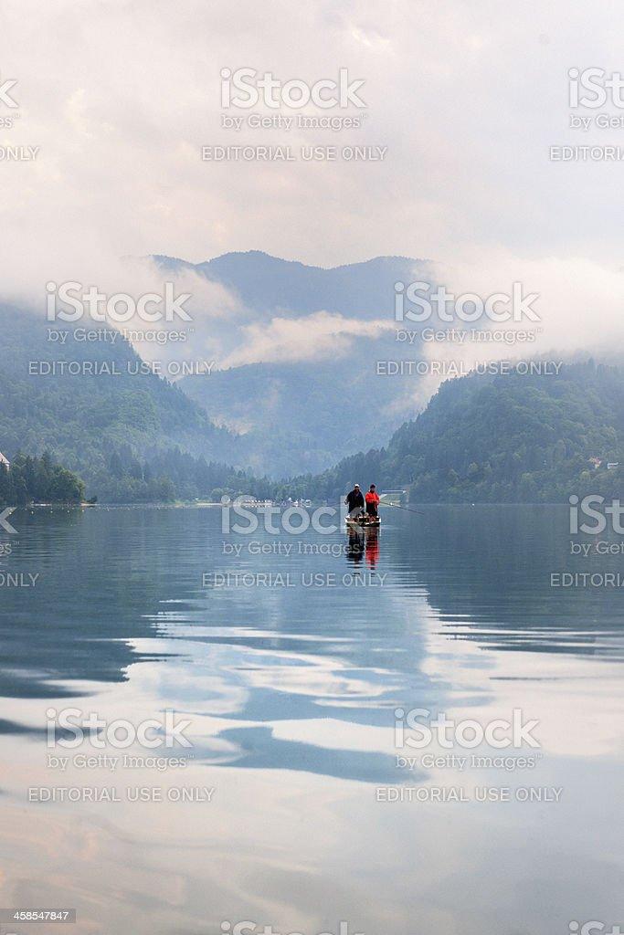 fishermen in rowboat fishing on Lake Bled Slovenia royalty-free stock photo