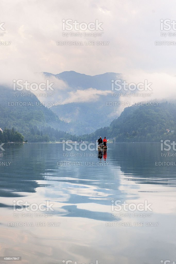 fishermen in rowboat fishing on Lake Bled Slovenia stock photo