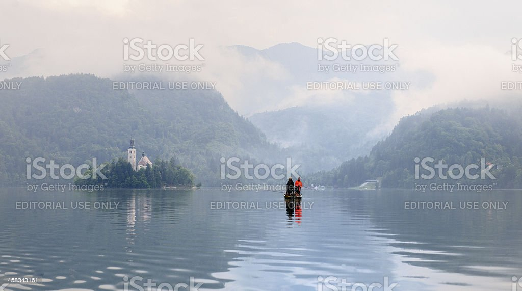 fishermen in rowboat on Lake Bled Slovenia stock photo