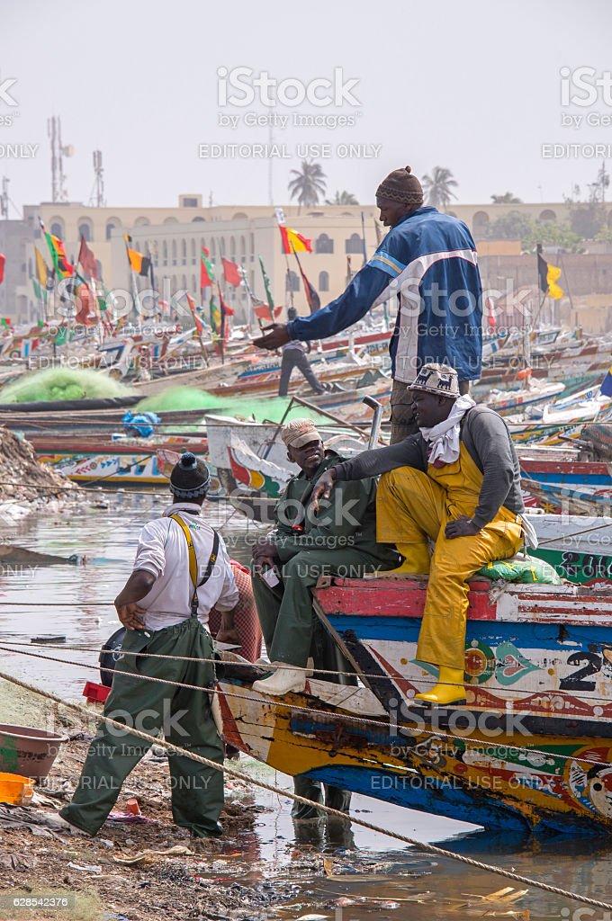 Fishermen in Sint Louis stock photo