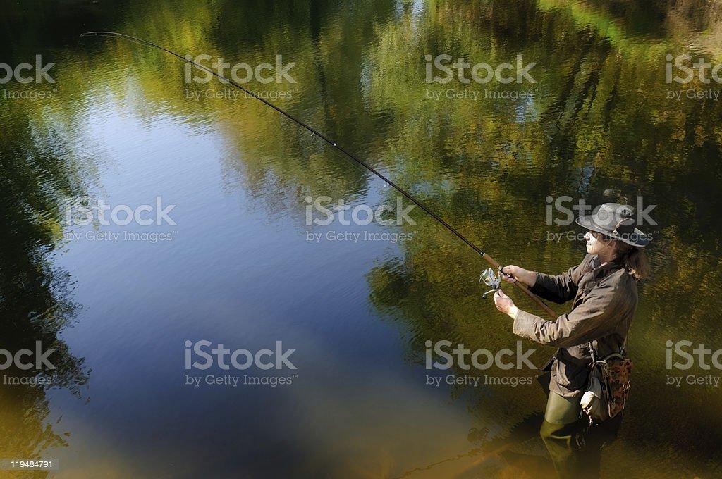 Fishermen in the autumn lake stock photo
